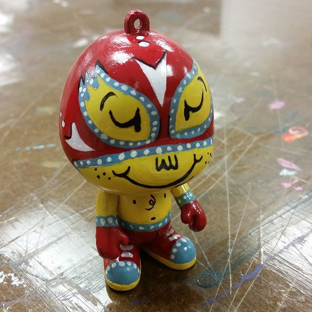"Just got done with this custom ornament for work. ""El Luchador"" #vinylcharacter #luchadores #characters"
